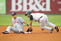 Micah Johnson (37) of the Kannapolis Intimidators steals second base ahead of the tag by Hagerstown Suns shortstop Stephen Perez (10) at CMC-Northeast Stadium on May 16, 2013 in Kannapolis, North Carolina.  The Suns defeated the Intimidators 10-7.   (Brian Westerholt/Four Seam Images)