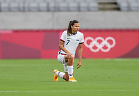 TOKYO, JAPAN - JULY 21: Tobin Heath #7 of the USWNT kneels before a game between Sweden and USWNT at Tokyo Stadium on July 21, 2021 in Tokyo, Japan.