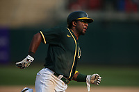 OAKLAND, CA - SEPTEMBER 25:  Elvis Andrus #17 of the Oakland Athletics rounds third and heads home to score the winning run in the bottom of the 9th inning on a double by Starling Marte #2 to beat the Houston Astros 2-1 during the game at the Oakland Coliseum on Saturday, September 25, 2021 in Oakland, California. (Photo by Brad Mangin)