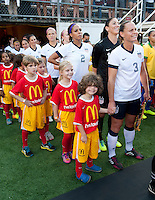 Player escorts, Christie Rampone, Hope Solo, Sydney Leroux, Kristie Mewis, Carli Lloyd.  The USWNT defeated Brazil, 4-1, at an international friendly at the Florida Citrus Bowl in Orlando, FL.