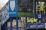 """Portsmouth 1 Southampton 1, 18/12/2012. Fratton Park, Championship. Police surveilence officers on duty inside Fratton Park stadium as Portsmouth take on take on local rivals Southampton in a Championship fixture. Around 3000 away fans were taken directly to the game in a fleet of buses in a police operation known as the """"coach bubble"""" to avoid the possibility of disorder between rival fans. The match ended in a one-all draw watched by a near capacity crowd of 19,879. Photo by Colin McPherson."""