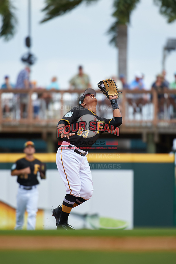 Pittsburgh Pirates second baseman Chris Bostick (63) catches a pop up during a Grapefruit League Spring Training game against the New York Yankees on March 6, 2017 at LECOM Park in Bradenton, Florida.  Pittsburgh defeated New York 13-1.  (Mike Janes/Four Seam Images)