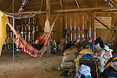 Mato Grosso State, Brazil. Aldeia Metuktire (Kayapo). Patrick Cunningham asleep in Waiwai's house, with Gilson.