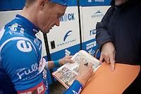 James Vanlandschoot (BEL/Wanty-Groupe Gobert) signing some newspaper snippets before the start<br /> <br /> 3 Days of De Panne 2015