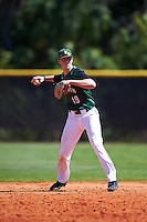 Dartmouth Big Green shortstop Nate Ostmo (19) warms up in between innings during a game against the Eastern Michigan Eagles on February 25, 2017 at North Charlotte Regional Park in Port Charlotte, Florida.  Dartmouth defeated Eastern Michigan 8-4.  (Mike Janes/Four Seam Images)