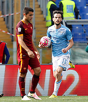 Calcio, Serie A: Lazio vs Roma. Roma, stadio Olimpico, 3 aprile 2016.<br /> Lazio's Marco Parolo, right, holds the ball after scoring during the Italian Serie A football match between Lazio and Roma at Rome's Olympic stadium, 3 April 2016.<br /> UPDATE IMAGES PRESS/Riccardo De Luca
