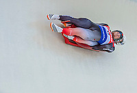 5 December 2014:  Tristan Walker and Justin Snith, sliding for Canada, bank into a turn on their first run ending the day with a 9th place finish and a combined 2-run time of 1:28.677 in the Doubles Competition at the Viessmann Luge World Cup, at the Olympic Sports Track in Lake Placid, New York, USA. Mandatory Credit: Ed Wolfstein Photo *** RAW (NEF) Image File Available ***
