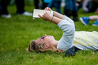 Hay on Wye, Wales, UK Saturday 28 May 2016<br /> Pictured: A young woman reads a book on the festival green<br /> Re: The 2016 Hay festival take place at Hay on Wye, Powys, Wales