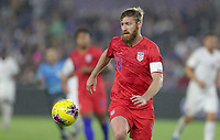 ORLANDO, FL - NOVEMBER 15: Tim Ream #13 of the United States moves with the ball during a game between Canada and USMNT at Exploria Stadium on November 15, 2019 in Orlando, Florida.