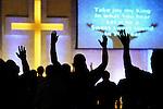 singing with hands raised in worship at Calvary Auroa, Colorado