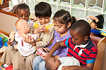 Education Preschool Headstart pretend play dressup group of four children boys and girl playing