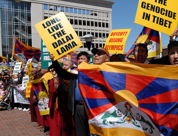 Tibetan protesters line the sidewalk outside the Coca Cola Company annual meeting Wednesday, April 16, 2008, in Wilmington, De. The protesters wanted Coca Cola to drop their corporate sponsorship of the Beijing Olympics. (AP Photo/Bradley C Bower)