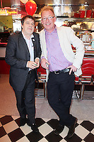 """NO REPRO FEE. 26/5/2011. NEW EDDIE ROCKET'S SHAKE SHOP. Tony O Brien and Peter Fortune are pictured in the new Eddie Rocket's Shake Shop. The design seeks to recall the vintage milkshake bars from 1950's America and re-imagine them for the 21st century. The new look aims to appeal to both young and old with a quirky and bold colour scheme and a concept of make-your-own milkshakes, based on the tag line """"You make it...We shake it!"""". Eddie Rocket's City Diner in the Stillorgan Shopping Centre in south Dublin has re-opened after an exciting re-vamp and the addition of a Shake Shop. Ten new jobs have been created with the Diner's re-launch bringing the total working in Eddie Rocket's Stillorgan to 30. Picture James Horan/Collins Photos"""