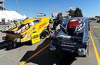 Oct. 30, 2011; Las Vegas, NV, USA: The cars of NHRA funny car drivers Cruz Pedregon (right) and Jeff Arend during the Big O Tires Nationals at The Strip at Las Vegas Motor Speedway. Mandatory Credit: Mark J. Rebilas-
