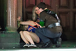 © Joel Goodman - 07973 332324 . 27/12/2017. Wigan, UK. A man and a woman tend to a woman who is slumped over in a doorway. Revellers in Wigan enjoy Boxing Day drinks and clubbing in Wigan Wallgate . In recent years a tradition has been established in which people go out wearing fancy-dress costumes on Boxing Day night . Photo credit : Joel Goodman