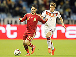 Spain's Isco (l) and Germany's Durm during international friendly match.November 18,2014. (ALTERPHOTOS/Acero)