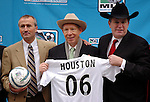 MLS head coach Dominic Kinnear, Houston Mayor Bill White and AEG president and CEO Timothy Leiweke pose for a photo during a news conference welcoming Major League Soccer to Houston outside Houston City Hall Friday Dec. 16,2005.