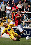 Leigh RMI 0, FC United of Manchester 0, 16/07/2005. Hilton Park, pre-season friendly. Visiting player Jonathan Mitten (in red) on the ball. FC United of Manchester were established by dissident Manchester United supporters in the wake of the Malcolm Glazer takeover of their club. They were admitted to the North West Counties League prior to the 2005-06. Photo by Colin McPherson.