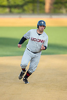Joe DeRoche-Duffin (22) of the UConn Huskies hustles towards third base against the Wake Forest Demon Deacons at Wake Forest Baseball Park on March 17, 2015 in Winston-Salem, North Carolina.  The Demon Deacons defeated the Huskies 6-2.  (Brian Westerholt/Four Seam Images)