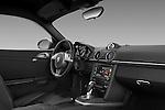 Passenger side dashboard view of a 2009 Porsche Cayman S.