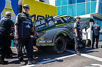 Mar 18, 2017; Gainesville , FL, USA; Jesse James (left) husband of NHRA funny car driver Alexis DeJoria with crew members during qualifying for the Gatornationals at Gainesville Raceway. Mandatory Credit: Mark J. Rebilas-USA TODAY Sports