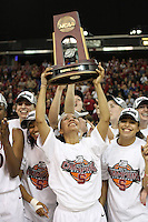 SACRAMENTO, CA - MARCH 29:  Rosalyn Gold-Onwude of the Stanford Cardinal holds the West Regional Trophy during the NCAA Women's Basketball Championship Elite Eight on March 29, 2010 at Arco Arena in Sacramento, California. Also pictured are Ashley Cimino, Melanie Murphy and Grace Mashore.