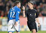 Dundee United v St Johnstone...12.03.14    SPFL<br /> Referee Crawford Allan has words with James Dunne<br /> Picture by Graeme Hart.<br /> Copyright Perthshire Picture Agency<br /> Tel: 01738 623350  Mobile: 07990 594431