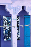 Blues and purples combine in the decoration of the exterior of this Indian dwelling