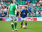 Hibs v St Johnstone….24.08.19      Easter Road     SPFL <br />Matty Kennedy takes on David Gray<br />Picture by Graeme Hart. <br />Copyright Perthshire Picture Agency<br />Tel: 01738 623350  Mobile: 07990 594431