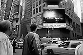 New York, New York.USA.March 21, 2003..The jumbo television screens and electronic signs in Times Square keep New Yorkers up-dated on the events in Iraq.