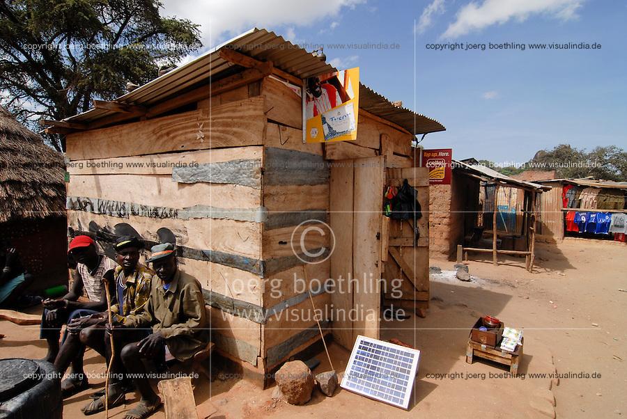 "Afrika Uganda Kotido , Solar Ladestation fuer Handy -  Energie Afrikaner afrikanisch xagndaz   .Africa Uganda Kotido , solar powered charging station for mobile phones - energy .  [ copyright (c) Joerg Boethling / agenda , Veroeffentlichung nur gegen Honorar und Belegexemplar an / publication only with royalties and copy to:  agenda PG   Rothestr. 66   Germany D-22765 Hamburg   ph. ++49 40 391 907 14   e-mail: boethling@agenda-fototext.de   www.agenda-fototext.de   Bank: Hamburger Sparkasse  BLZ 200 505 50  Kto. 1281 120 178   IBAN: DE96 2005 0550 1281 1201 78   BIC: ""HASPDEHH"" ,  WEITERE MOTIVE ZU DIESEM THEMA SIND VORHANDEN!! MORE PICTURES ON THIS SUBJECT AVAILABLE!! ] [#0,26,121#]"