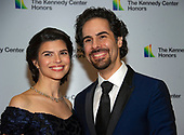 Alex Lacamoire and and his wife, Illeana Ferreras, arrive for the formal Artist's Dinner honoring the recipients of the 41st Annual Kennedy Center Honors hosted by United States Deputy Secretary of State John J. Sullivan at the US Department of State in Washington, D.C. on Saturday, December 1, 2018. The 2018 honorees are: singer and actress Cher; composer and pianist Philip Glass; Country music entertainer Reba McEntire; and jazz saxophonist and composer Wayne Shorter. This year, the co-creators of Hamilton writer and actor Lin-Manuel Miranda, director Thomas Kail, choreographer Andy Blankenbuehler, and music director Alex Lacamoire will receive a unique Kennedy Center Honors as trailblazing creators of a transformative work that defies category.<br /> Credit: Ron Sachs / Pool via CNP