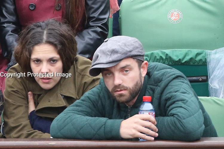 Alyson Paradis and boyfriend Guillaume Gouix watching tennis during Roland Garros tennis open 2016 in Paris on June 02 2016.