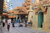 Myanmar, Burma, Yangon.  Sule Pagoda, Early-Morning Worshipers.