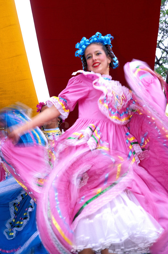 Costumed girl dancing at Cinco de Mayo celebration, Old Town State Historic Park, San Diego, California