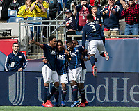 Foxborough, Massachusetts - March 30, 2019: In a Major League Soccer (MLS) match, New England Revolution (blue/white) defeated Minnesota United FC (white), 2-1, at Gillette Stadium.<br /> Brandon Bye celebrates his goal with teammates.