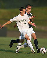 04 September 2009: Matt Armstrong #15 of the University of Notre Dame moves in to tackle Anthony Arena #3 of Wake Forest University during an Adidas Soccer Classic match at the University of Indiana in Bloomington, In. The game ended in a 1-1 tie..