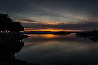 Sunset glows at the San Leandro Marina Park along San Francisco Bay.