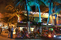 Bars and hotels and shopping along Ocean Ave in South Beach--also nicknamed SoBe, a neighborhood of the city of Miami Beach, Florida. It encompasses roughly the southernmost 23 blocks of the main barrier island that separates the Atlantic Ocean and Biscayne Bay. This area was the first section of Miami Beach to be developed, starting in the 1910s, thanks to the development efforts of Carl G. Fisher, the Lummus Brothers, John S. Collins, and others. The area has gone through numerous artificial and natural changes over the years, including a booming regional economy, increased tourism, and the 1926 hurricane, which destroyed much of the area..In the 1930s, an architectural revolution came to South Beach, bringing Art Deco, Streamline Moderne, and Nautical Moderne architecture to the Beach.