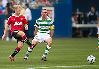 July 16, 2010 Paul Scholes No. 18 of Manchester United and Scott Brown No. 8 of Celtic FC during an international friendly between Manchester United and Celtic FC at the Rogers Centre in Toronto.