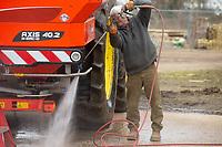 6-3-2021 Pressure washing a fertiliser spreader <br /> ©Tim Scrivener Photographer 07850 303986<br />      ....Covering Agriculture In The UK....
