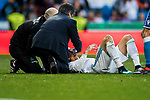 Cristiano Ronaldo of Real Madrid lies injured on the pitch as he was kicked close to his left eye by Fabian Lukas Schar of RC Deportivo La Coruna during the La Liga 2017-18 match between Real Madrid and RC Deportivo La Coruna at Santiago Bernabeu Stadium on January 21 2018 in Madrid, Spain. Photo by Diego Gonzalez / Power Sport Images