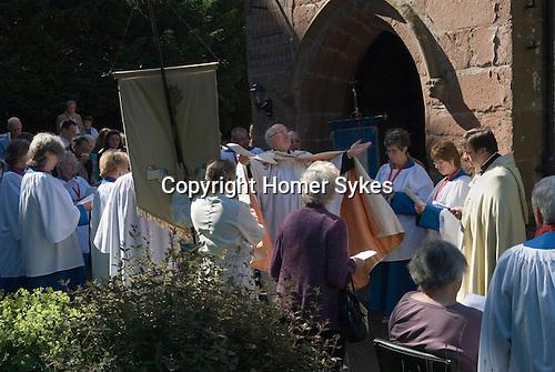 Church Clipping Ceremony St Peters Church, Edgmontd, Shropshire Uk 2015.<br /> The Revd Prebendary Edward Ward.