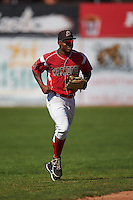 Batavia Muckdogs outfielder Stone Garrett (11) jogs to the dugout during a game against the State College Spikes August 23, 2015 at Dwyer Stadium in Batavia, New York.  State College defeated Batavia 8-2.  (Mike Janes/Four Seam Images)