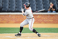 Charlie White (4) of the Maryland Terrapins follows through on his swing against the Wake Forest Demon Deacons at Wake Forest Baseball Park on April 4, 2014 in Winston-Salem, North Carolina.  The Demon Deacons defeated the Terrapins 6-4.  (Brian Westerholt/Four Seam Images)