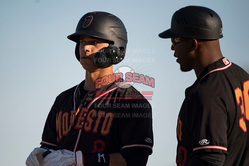 Modesto Nuts shortstop Bryson Brigman (8) talks to hitting coach Joe Thurston (30) during a California League game against the San Jose Giants at John Thurman Field on May 9, 2018 in Modesto, California. San Jose defeated Modesto 9-5. (Zachary Lucy/Four Seam Images)