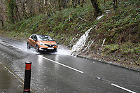 Pictured: A car drives through a flooded road in Troedyrhiw near Merthyr Tydfil, Wales, UK. Sunday 16 February 2020<br /> Re: Storm Dennis has been affecting parts of Wales, UK.