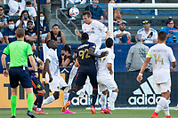 CARSON, CA - JUNE 19: Daniel Steres #5 of the Los Angeles Galaxy heads a ball during a game between Seattle Sounders FC and Los Angeles Galaxy at Dignity Health Sports Park on June 19, 2021 in Carson, California.