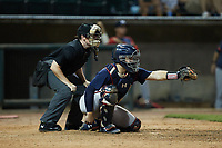 Mississippi Braves catcher Shea Langeliers (4) frames a pitch as home plate umpire Austin Jones looks on during the game against the Birmingham Barons at Regions Field on August 3, 2021, in Birmingham, Alabama. (Brian Westerholt/Four Seam Images)