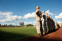 Members of the Marines stand on the field prior to a game between the Corpus Christi Hooks and the Springfield Cardinals at Hammons Field on August 13, 2011 in Springfield, Missouri. Springfield defeated Corpus Christi 8-7. (David Welker / Four Seam Images)